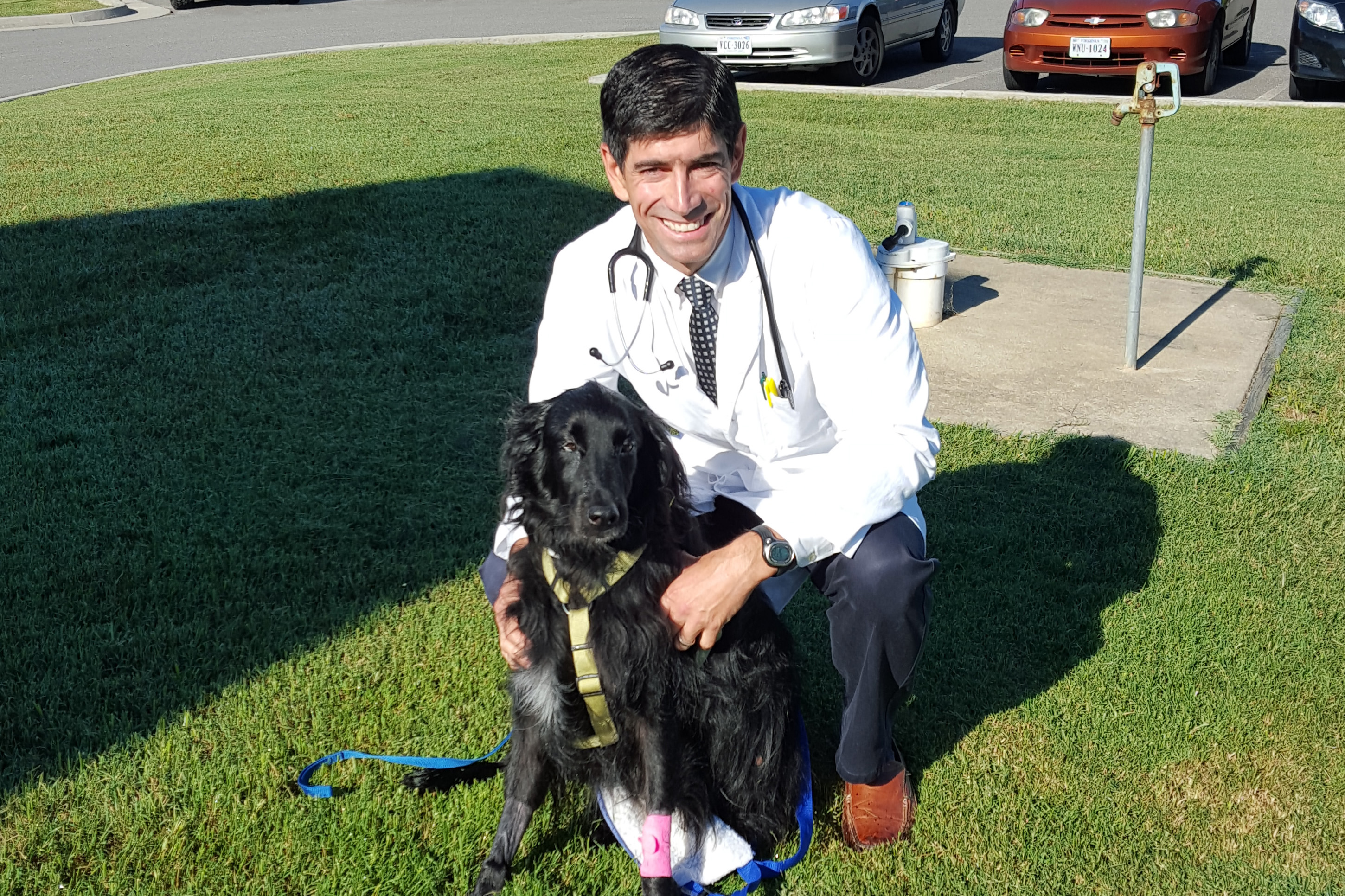 Dr. Clarke with Jett outside in the yard